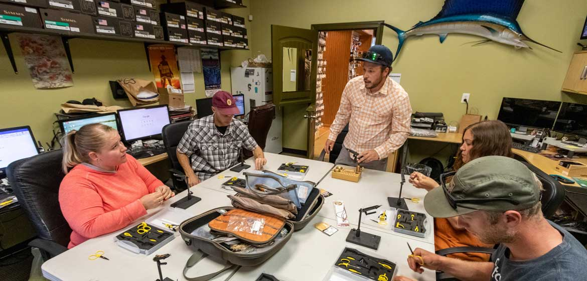 A group of students taking a fly tying class at Fishwest in Sandy, UT