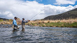 fly fishing guide and customer wade in the Weber River